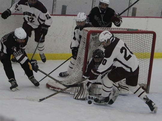 Scarsdale goalie Sam Seltzer and teammate Corey Waldman hold off a wrap-around attempt from Orchard Park's Liam McGowan during an ice hockey game between Scarsdale and Orchard Park at the Ice Hutch in Mount Vernon on Saturday, Dec. 3rd, 2016. Orchard Park won 3-2.