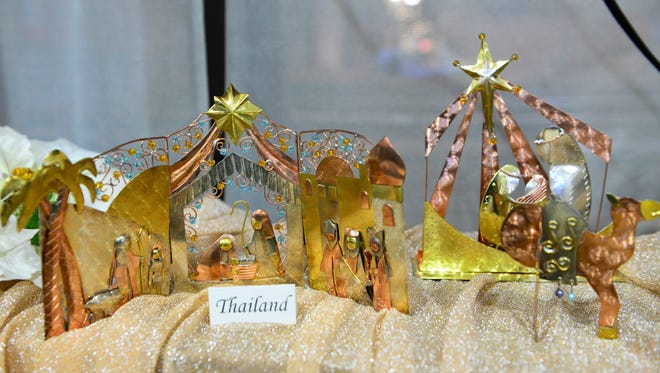 St. Paul Evangelical Lutheran Church members and volunteers set up tables of nativity sets on Dec. 2. The church will open its doors for the Wonder of Christmas event Dec. 4 to 6 and 11 to 13.