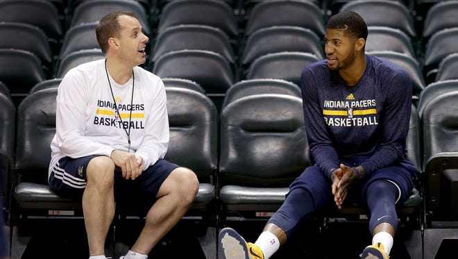 Indiana Pacers practice for their second game agains the Atlanta Hawks Monday, April 21, 2014, afternoon at Banker Life Fieldhouse. Here Pacers head coach Frank Vogel talks with Paul George following practice.