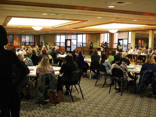 Ottawa County officials and other health care professionals