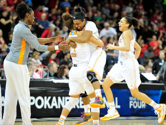 Tennessee guard Andraya Carter, left, hugs guard Ariel Massengale after defeating Gonzaga 73-69 in OT during the Sweet 16 game at Spokane Arena in Spokane, Wash., on Saturday, March 28, 2015.