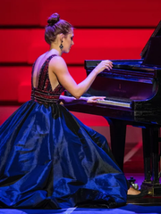 "Alexandria-native Elizabeth Ohl, who has been playing piano since 1st grade, preformed ""Interstellar Main Theme"" for the talent category in the 61st annual Distinguished Young Women competitions."