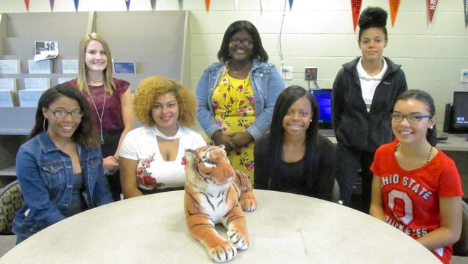 """Mansfield Senior High School homecoming queen candidates are from left, seated, seniors Shamari Allen, Cassidy Williams, Alaya Grose and Keeley Weese. Attendants, standing from left, are junior Aby Wilcox, sophomore Yahsneik Nixon and freshman Aniyah Rill. The queen will be announced during an afternoon assembly on Oct. 6 just hours before the Tygers welcome Ashland to Arlin Field. The homecoming dance, """"A Night on the Red Carpet,"""" will be from 8 to 11 p.m.Oct. 7 in the Senior High commons."""