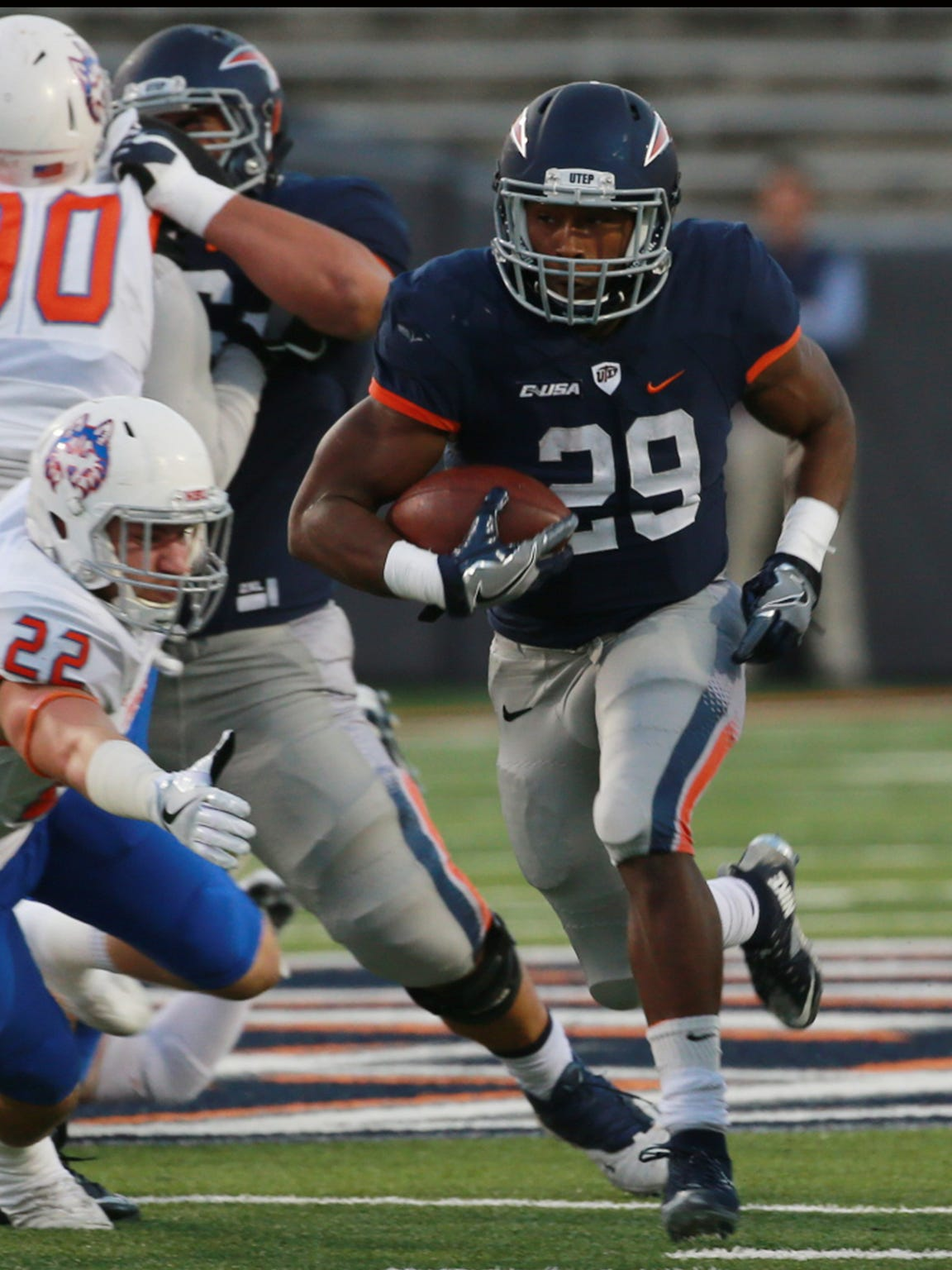 UTEP's Aaron Jones runs past Houston Baptist defender