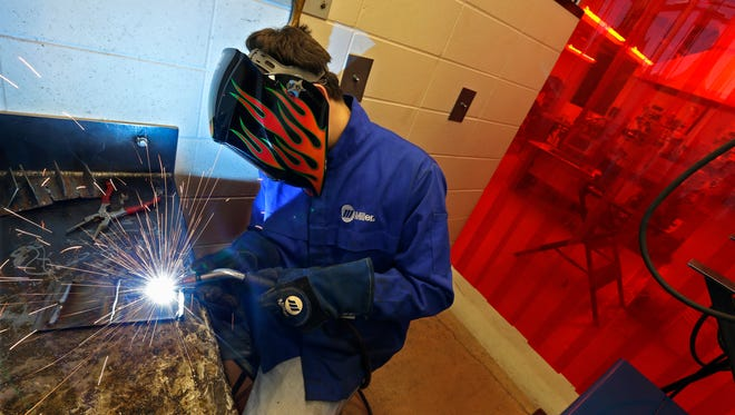 Mason Lettau welds steel in the welding and machining area of the Appleton Technical Academy at Appleton West High School. The charter school has a curriculum and classes designed specifically for students who want to pursue careers in skilled trades.