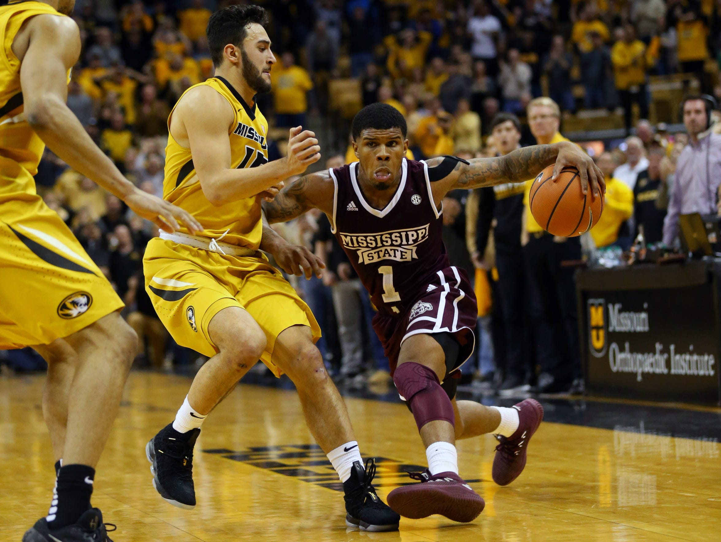 Mississippi State Bulldogs guard Lamar Peters (1) commits an offensive foul against Missouri Tigers guard Jordan Geist (15) in overtime at Mizzou Arena.