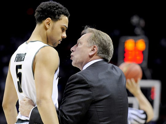 MSU head coach  Tom Izzo has a talk with Bryn Forbes after a Spartan  defensive lapse against  Georgia during their NCAA game in Charlotte, NC Friday 3/20/2015.