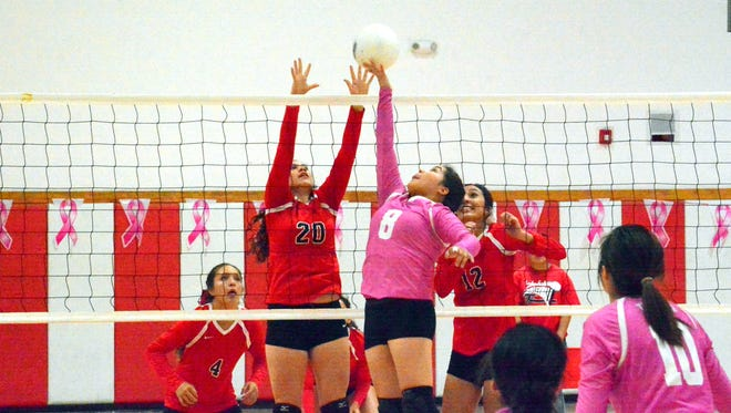 Loving's Jacqueline Pierce tries to deflect the ball against Tularosa's Cyan Fossum in the second set Thursday.