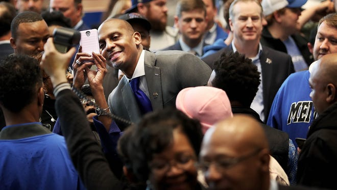 A crowd of fans gathers around Penny Hardaway during a news conference at the University of Memphis to announce the former Tigers star as its new men's basketball coach at the Laurie-Walton Family Basketball Center.