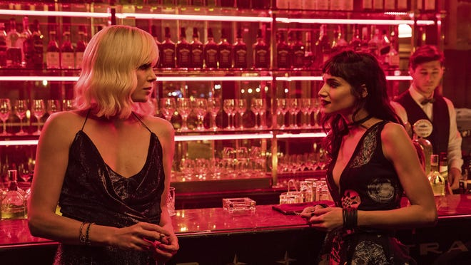 "This image released by Focus Features shows Charlize Theron, left, and Sofia Boutella in ""Atomic Blonde."""