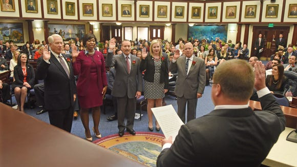 New House members are sworn in by Judge Nicholas Thompson, during Organization Session, November 22, 2016. From the left, Rep. Don Hahnfeldt, R-The Villages; Rep. Kamia Brown, D-Ocoee; Rep. Ralph Massullo, R-Lecanto; Rep. Amber Mariano, R-Hudson; and Rep. Sam Killebrew, R-Winter Haven.
