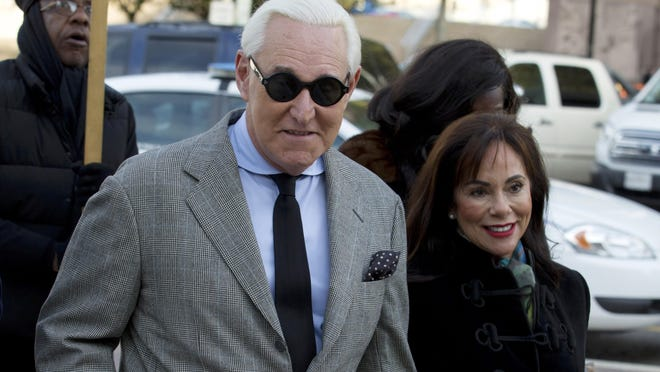 Roger Stone accompanied by his wife, Nydia Stone, right, arrives at federal court on Nov. 14. in Washington .