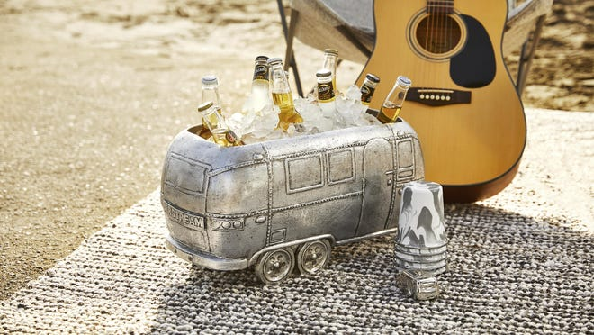 In a new collaboration with the RV company Airstream, Pottery Barn has launched a collection of gear that includes a fun drinks cooler shaped like the iconic trailer, shown here, as well as logo-embroidered napery and tumblers, bowls and plates in a snazzy grey and white enamelware swirl pattern.