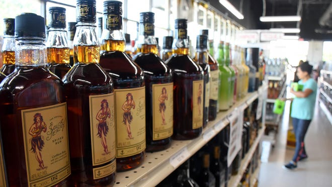 Bottles of rum are seen on a shelf at Reggis Liquor. Prosper-area residents voted in favor of a couple of alcohol sales measures during the Nov. 3 election.