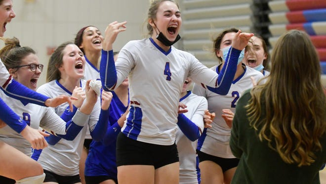 Seaman's volleyball team celebrates its Class 5A sub-state championship Saturday on the Vikings' home court.