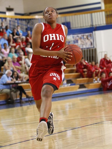 Kelsey Mitchell drives to the basket.