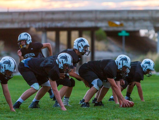 The Canyon View High football team practices on Monday,