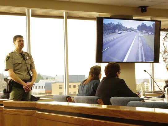 Sophia Downing, 36, watches footage of the fatal crash