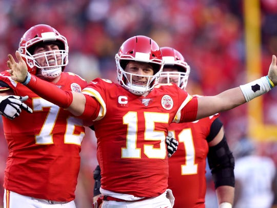 KANSAS CITY, MISSOURI - JANUARY 19: Patrick Mahomes #15 of the Kansas City Chiefs reacts with teammates Eric Fisher #72 and Mitchell Schwartz #71 after a fourth quarter touchdown pass against the Tennessee Titans in the AFC Championship Game at Arrowhead Stadium on January 19, 2020 in Kansas City, Missouri. (Photo by Jamie Squire/Getty Images)