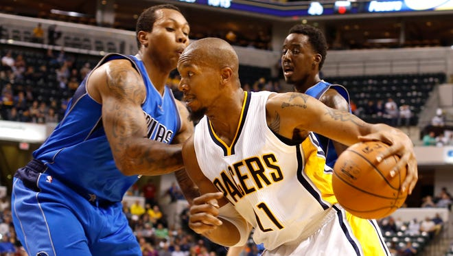 Indiana Pacers' David West tires to get around Dallas Mavericks' Greg Smith in the first half of the game at Bankers Life Fieldhouse Saturday October 18, 2014.