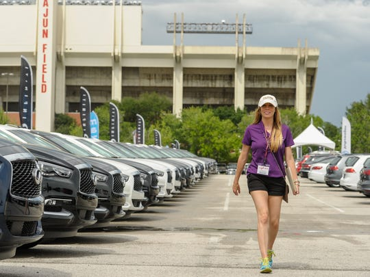 Bonnie Simon, Sales Consultant at Infiniti of Lafayette preparing for the opening of the car show at Cajun Field.  May 2, 2016.
