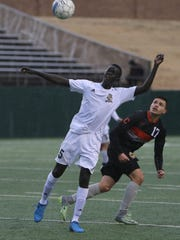 Rider's Okunyi Cham heads the ball in the game against