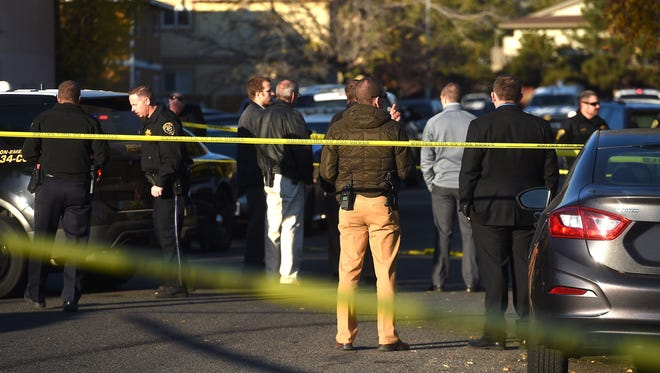 Police investigate a shooting near the intersection of Parkview St. and Mazzone Ave. in Reno on Nov. 2, 2017.