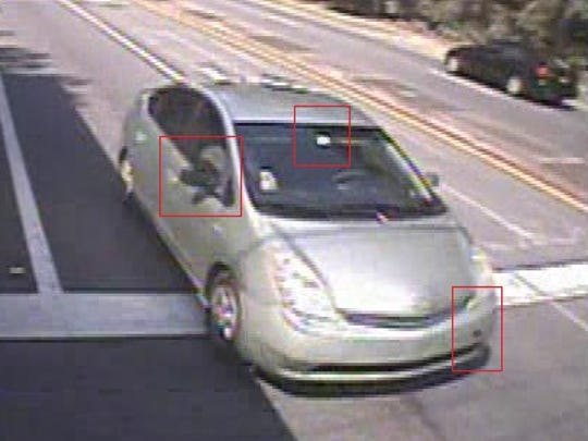 """TPD officials say surveillance photos show the 2006-2009 model Toyota Prius seen leaving the scene, painted """"Silver Pine Mica,"""" was missing a tow-bolt cover on its front bumper and had a mismatching black passenger-side mirror."""