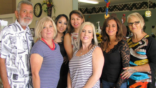 The staff at Desert Oasis Day Spa and Salon posed with Abby Scepka (second from left) during the announcement of her retirement as a hair stylist after 28 years. From left are, Raymond Montoya Aguilar, Scepka, Crystal Garcia, Teresa ortega, Amber Alba, Selina Cook Jordan and spa owner Diana Chadborn.