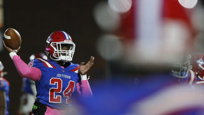 Jefferson's Malaki Starks (24) throws a pass during warm-ups before an GHSA high school football between Jefferson and Chestatee in Jefferson, Ga., on Thursday, Nov. 5, 2020.