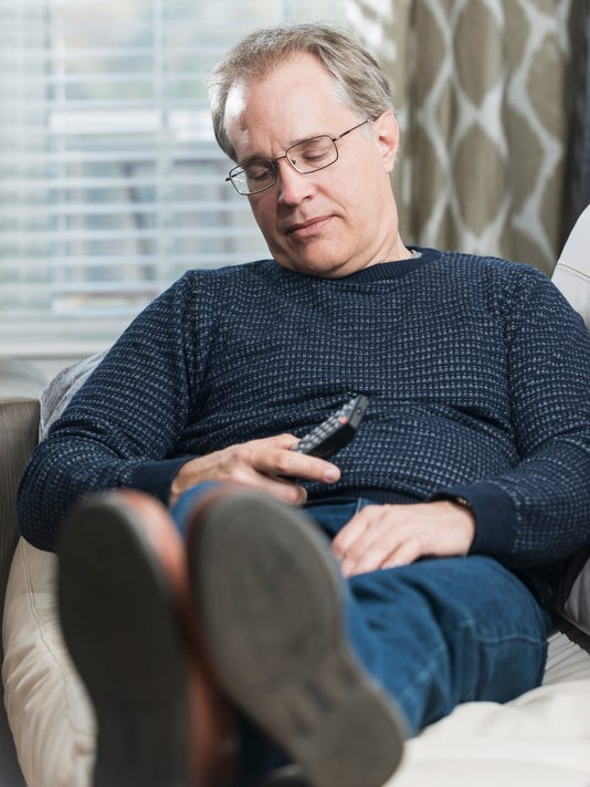 Mature man fell asleep watching TV