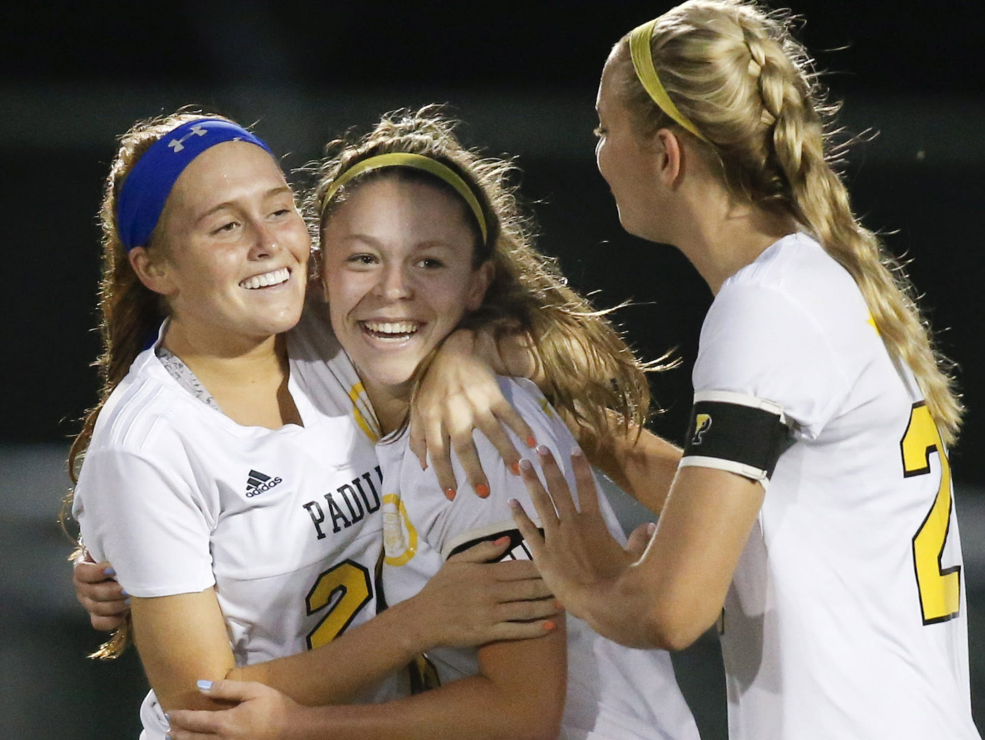 Padua's Sarah Brush (center) celebrates her opening goal with Mackenzie Scully (left) and Molly Drach in the first half against Caesar Rodney in the DIAA Division I state title game at Smyrna High School on Friday.