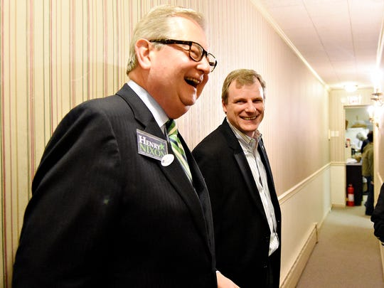 City Councilmen Michael Helfrich, right, and Henry Nixon, left, share a laugh during election night at the Democratic Party Headquarters on South Duke Street in York, Pa. on Tuesday, Nov. 3, 2015. Dawn J. Sagert - dsagert@yorkdispatch.com