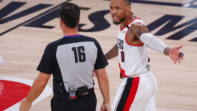 Damian Lillard of the Portland Trail Blazers argues with referee David Guthrie Aug. 24