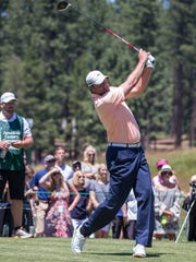 Derek Lowe hits a tee shot during the American Century Championship at Edgewood Tahoe Golf Course in Stateline, Nevada, Saturday.