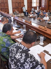 Senators of the Guam Legislature listen to testimony from residents, during a public hearing on a bill allowing the government to borrow money to pay taypayer refunds, at the GUam Congress Building in Hagåtña on Friday, May 5, 2017.