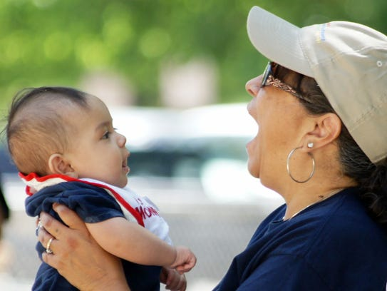Gloria Lopez gets the attention of her granddaughter