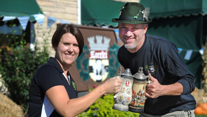 Lorelei Inn owners Meagan Colombo, left, and Dave Hack will toast the 10th anniversary of their popular Oktoberfest Friday and Saturday in Allouez.