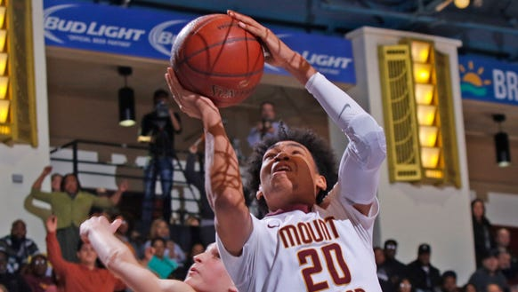 Mount Vernon's Jason Douglas-Stanley (20) puts up a