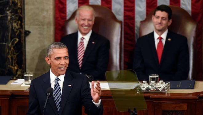 Vice President Joe Biden and House Speaker Paul Ryan listen as President Barack Obama gives his State of the Union Address to a joint session of Congress on Capitol Hill in Washington on Tuesday. The president called on Biden to lead a federal initiative aimed at curing cancer.