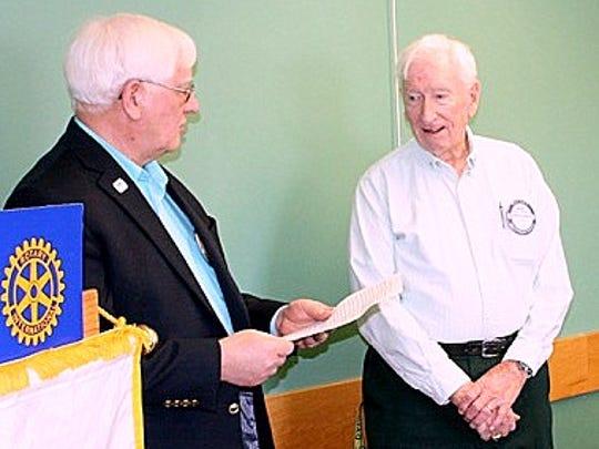 Bath Rotarian Mike Slovak, left, presents Dave Wheeler with an honorary club membership.