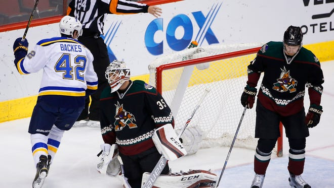 St. Louis Blues' David Backes (42) celebrates a goal by teammate Alexander Steen against Arizona Coyotes goalie Louis Domingue (35) as Coyotes' Klas Dahlbeck (34), of Sweden, skates past during the first period of an NHL hockey game Saturday, Feb. 20, 2016, in Glendale, Ariz. (AP Photo/Ross D. Franklin)