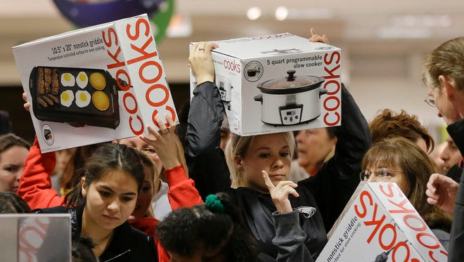Shoppers rush to grab electric griddles and slow cookers on sale shortly after the doors opened at a J.C. Penney store.