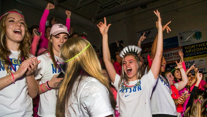 Bridgette Buttrum, 17, a senior, right, cheers during an assembly at Sandra Day O'Connor High School when it was announced that the school won the Arizona Sports Awards Fan Experience Fall Award , Friday, January 27, 2017.