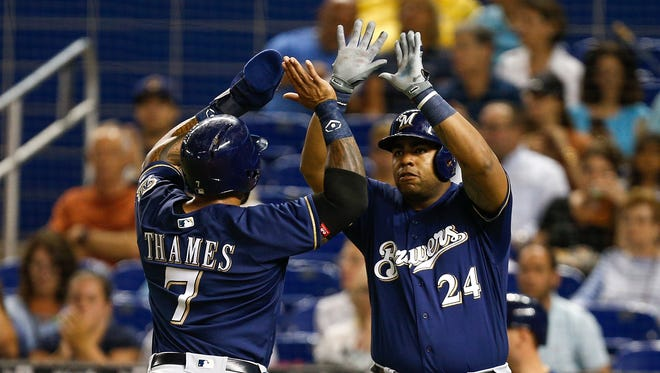 Eric Thames celebrates a run with Jesus Aguilar.
