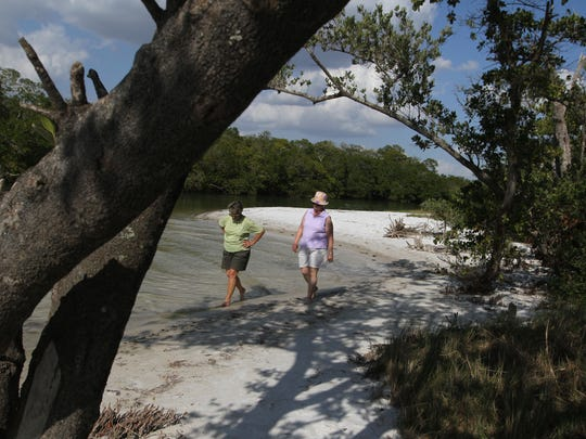 Beachgoers enjoy a walk at Bunche Beach Preserve in south Fort Myers.