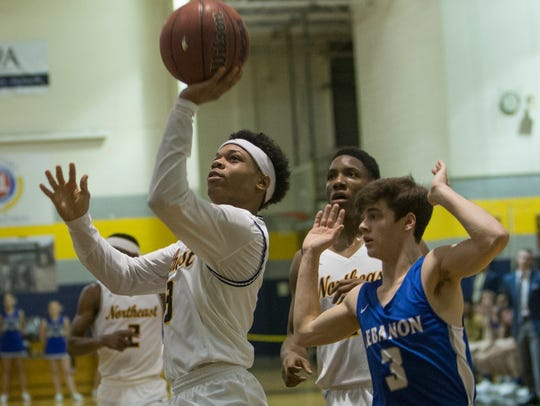 Shaun Robinson, 3, shoots a lay-up during Northeast's