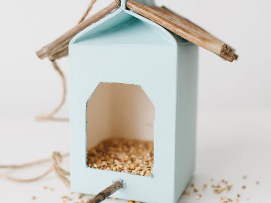 Turn a used juice or milk carton into a birdhouse.