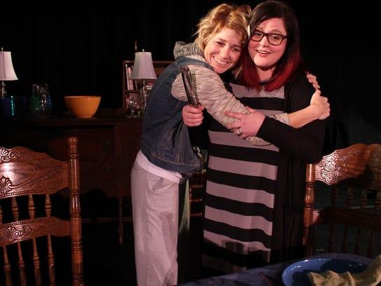 Karen Weston (Andrea Robison) hugs her older sister
