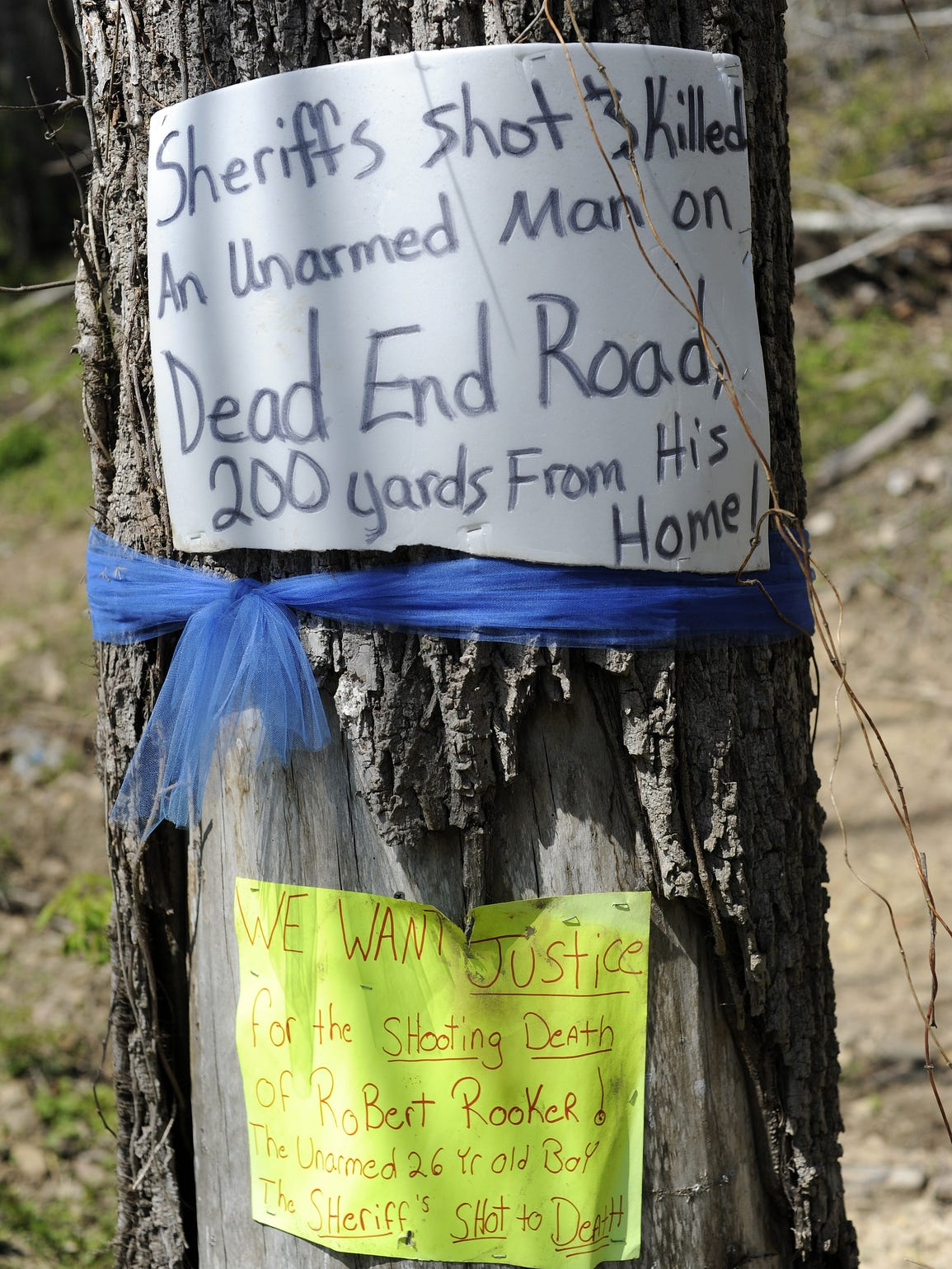 In April 2015, signs lined the road where a police